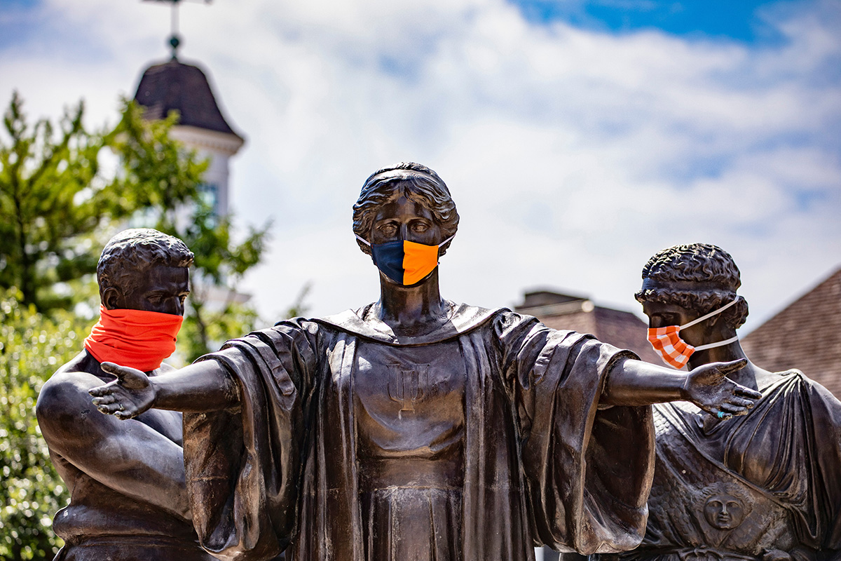 The Alma Mater statue wears a mask, as do Labor and Learning behind her.