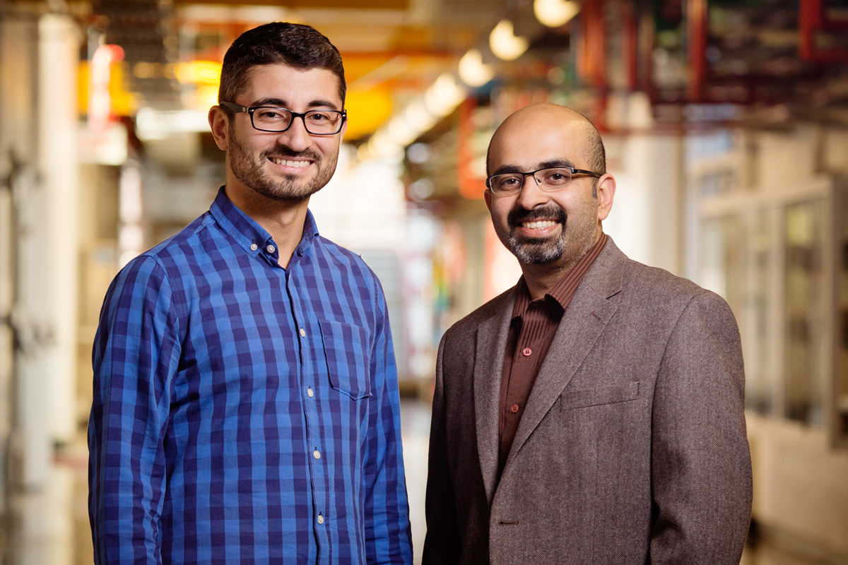 A robot under development at the University of Illinois automates the labor-intensive process of crop phenotyping, enabling scientists to scan crops and match genetic data with the highest-yielding plants. Agricultural and biological engineering professor Girish Chowdhary, right, is working on the $3.1 million project, along with postdoctoral researcher Erkan Kayacan.