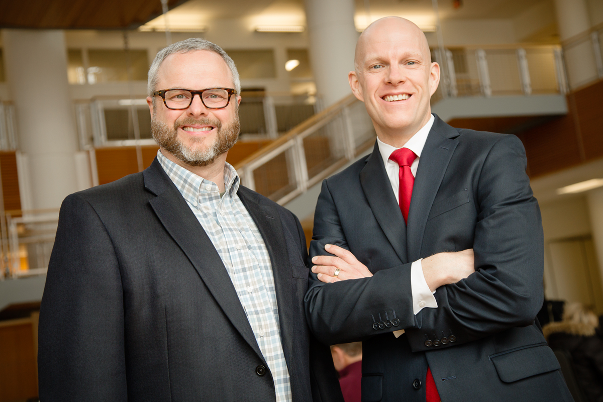 Photo of business professors Jessen L. Hobson, right, and Mark Peecher.