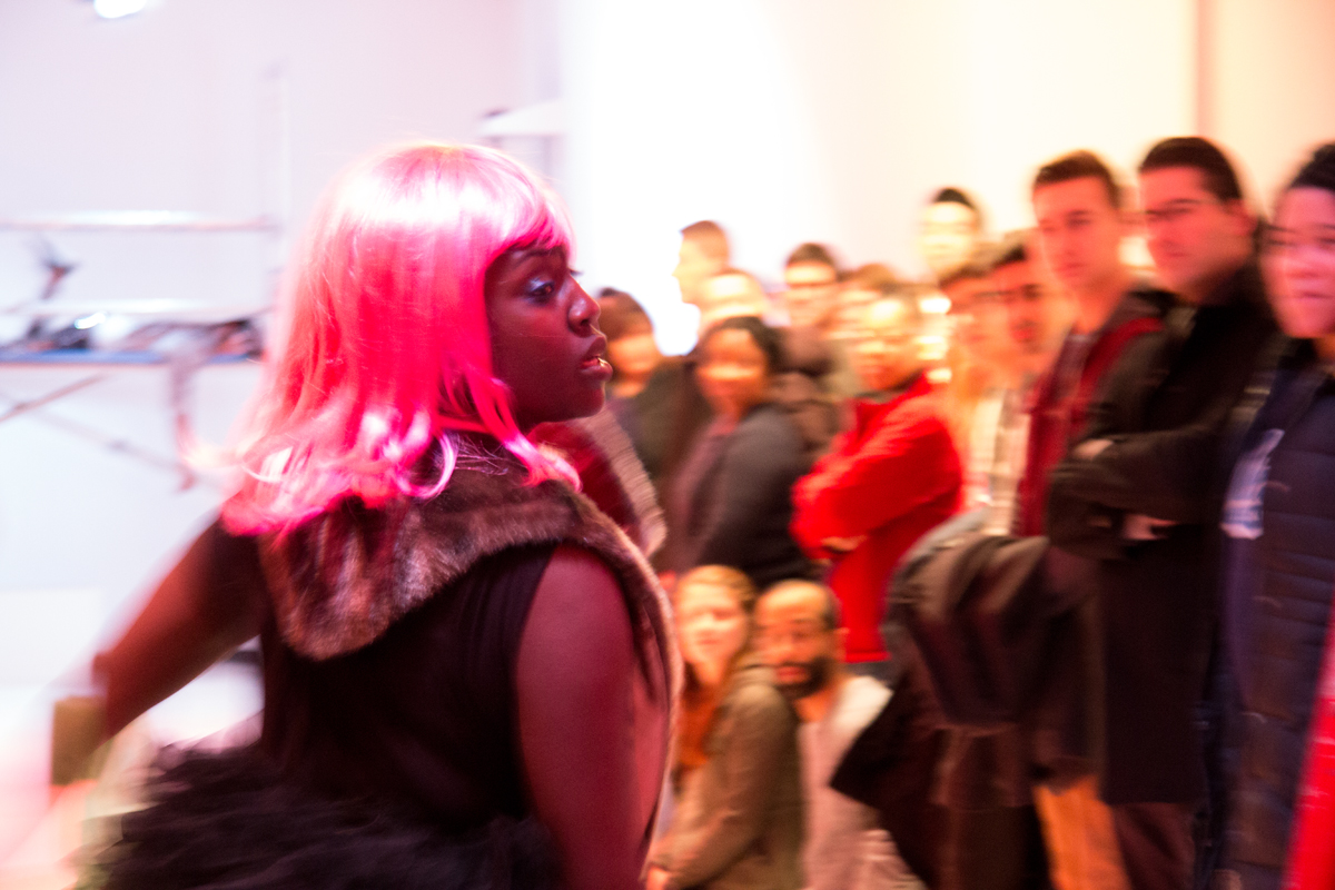 Performance artist Autumn Knight dances in front of a crowd