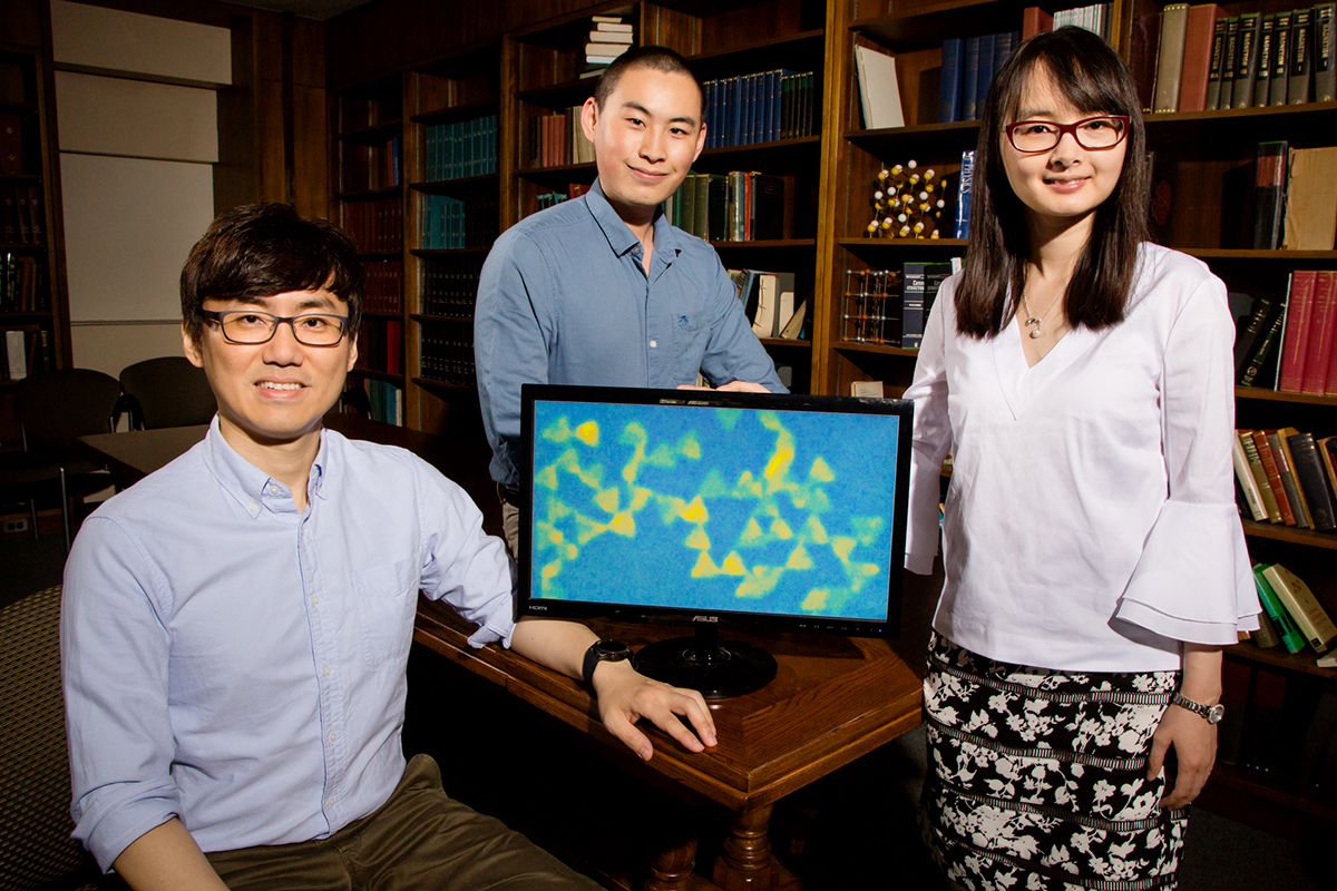 University of Illinois postdoctoral researcher Juyeong Kim, left, graduate student Zihao Ou and professor Qian Chen have developed a new technique for observing colloidal nanoparticles while they interact and self-assemble.