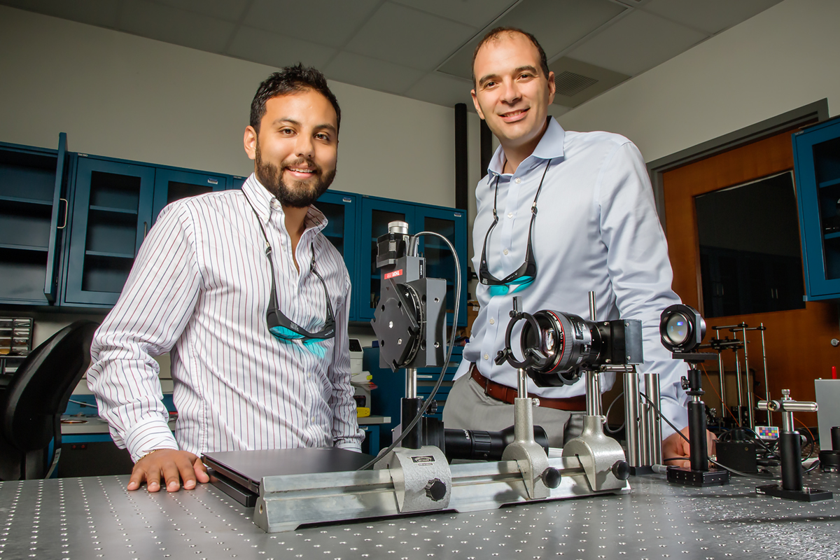 Illinois electrical and computer engineering professor Viktor Gruev, right, and graduate student Missael Garcia have developed a camera capable of sensing both color and polarization by mimicking the eye of the mantis shrimp that may improve early cancer detection and provide new understanding of underwater phenomena.