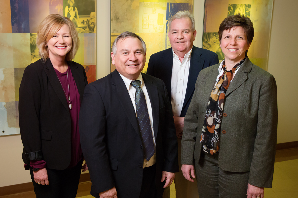 Principal investigator Janet Liechty, right, is leading a $1.9 million initiative in the School of Social Work that provides behavioral health services to underserved areas in Illinois. Co-investigators on the project are, from left: assistant dean for field education Mary Maurer; Peter Mulhall, the director of the Center for Prevention Research and Development; and Michael Glasser, an associate dean, U. of I. College of Medicine, Rockford.