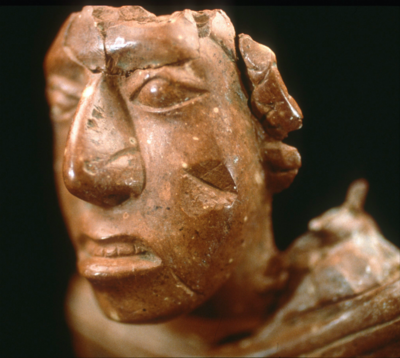 Face of an ancient female figurine.