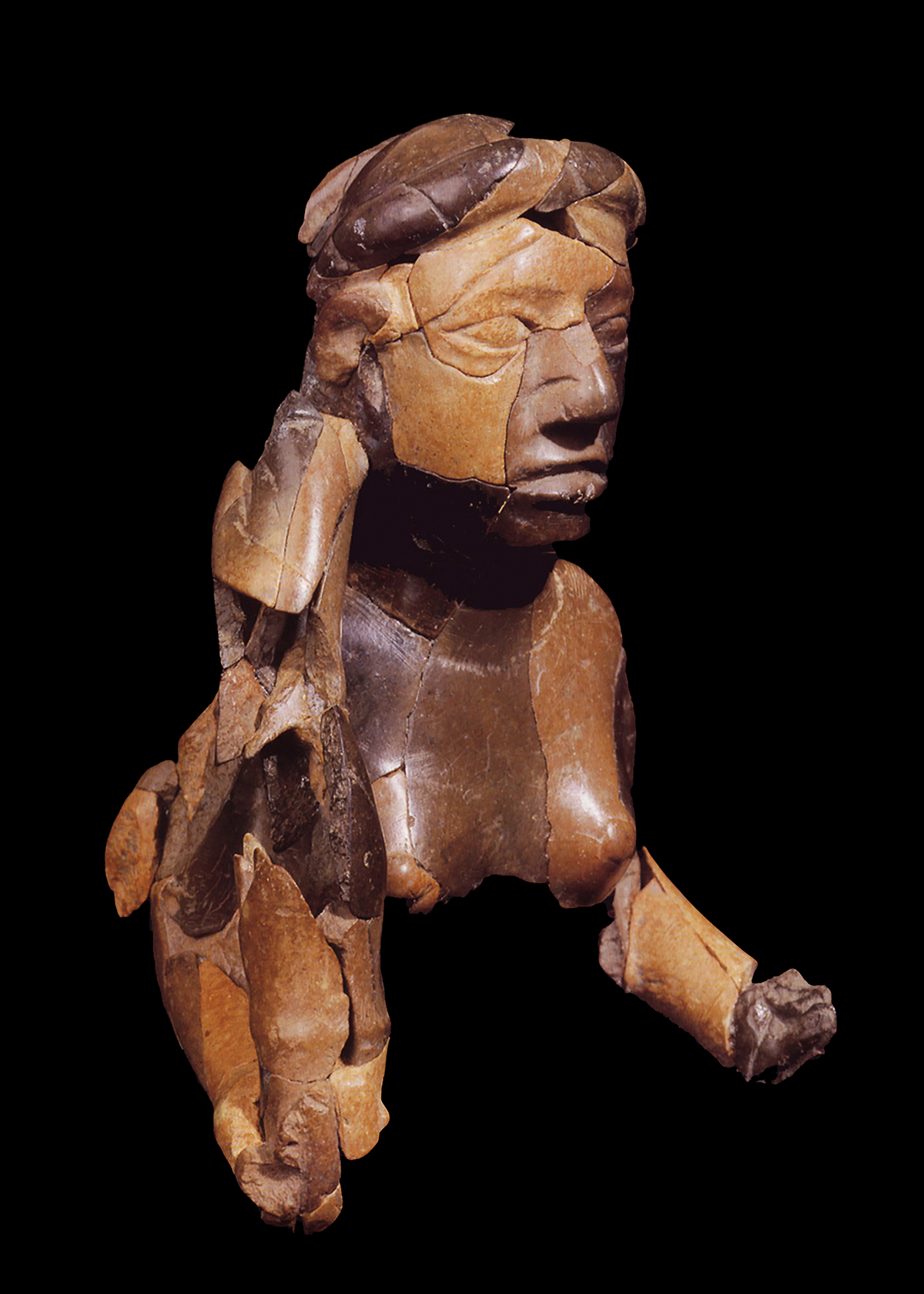 A new exhibit includes the upper torso and head of a red goddess sculpture, carved from stone and found buried at the ancient American Indian city of Cahokia. Note the serpent wrapped around her head. This artifact dates to the 12th century.