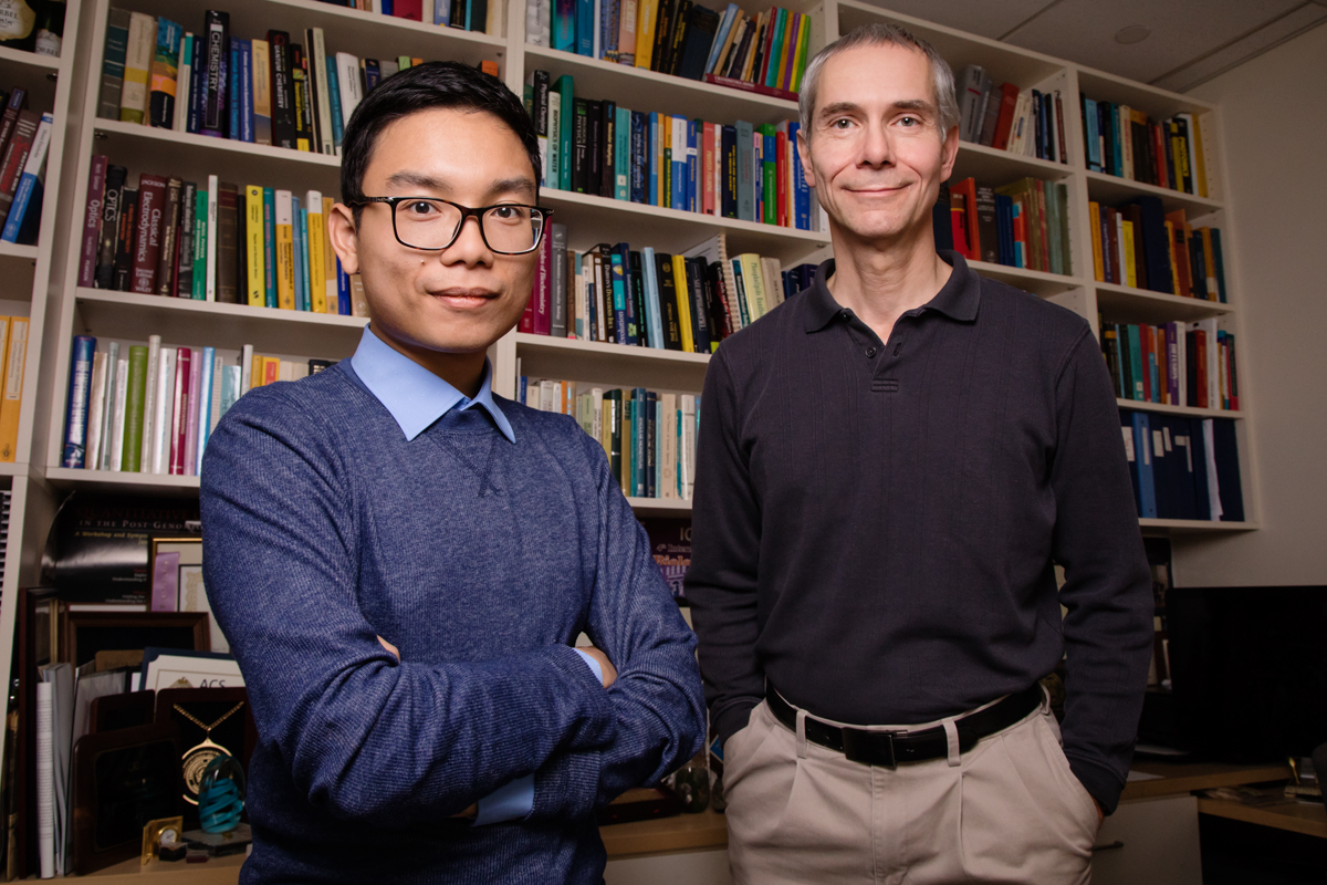 Martin Gruebele, right, and graduate student Duc Nguyen led a team that is the first to demonstrate imaging of individual nanoparticles at different orientations while in a laser-induced excited state.