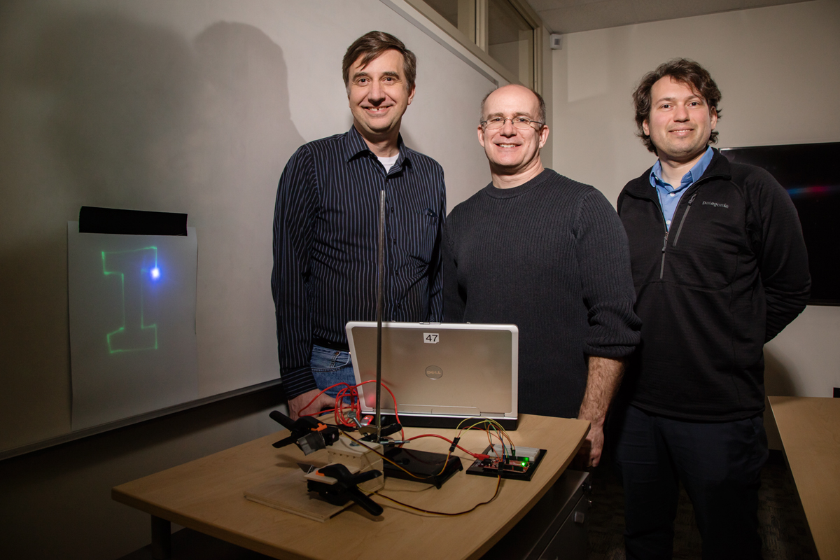 Students in an area middle school learned principles of coordinate math and computer programming by creating a laser light show in a collaborative project started by University of Illinois researchers in education and engineering. The team, from left, Joe Muskin, a visiting education coordinator in mechanical science and engineering; Adam Poetzel, an instructor of mathematics education in curriculum and instruction; and Arend van der Zande, a professor of mechanical science and engineering.