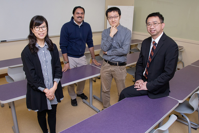 A team led by social work professor Kevin Tan, right, found in a recent study that girls are more likely than boys to struggle with significant academic, behavioral and social needs than boys during eighth and ninth grade. The team, left to right, includes graduate students Esther Shin, Gaurav Sinha and Yang Wang.