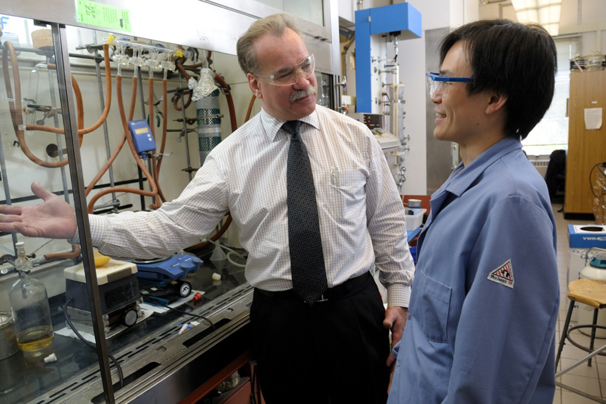 Illinois chemistry professor Scott E. Denmark, left, with former graduate student Timothy Chang. Denmark was elected to the National Academy of Sciences.