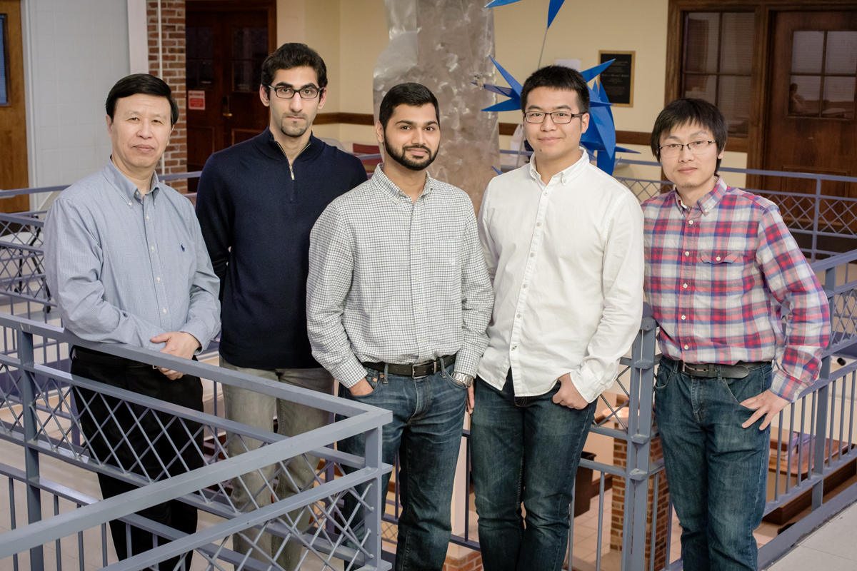 Illinois mechanical sciences and engineering professor Ning Wang, left, graduate students Erfan Mohagheghian and Gaurav Chaudhary, and postdoctoral researchers Junwei Chen and Jian Sun are measuring mechanical forces within cells to help unlock some of the mysteries of embryonic development and cancer.