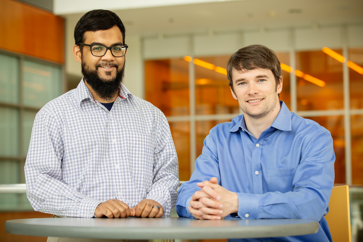 Illinois professor Andrew Smith, right, and graduate student Mohammad Zahid developed a technique to track molecules that deliver drugs and genes to cells.