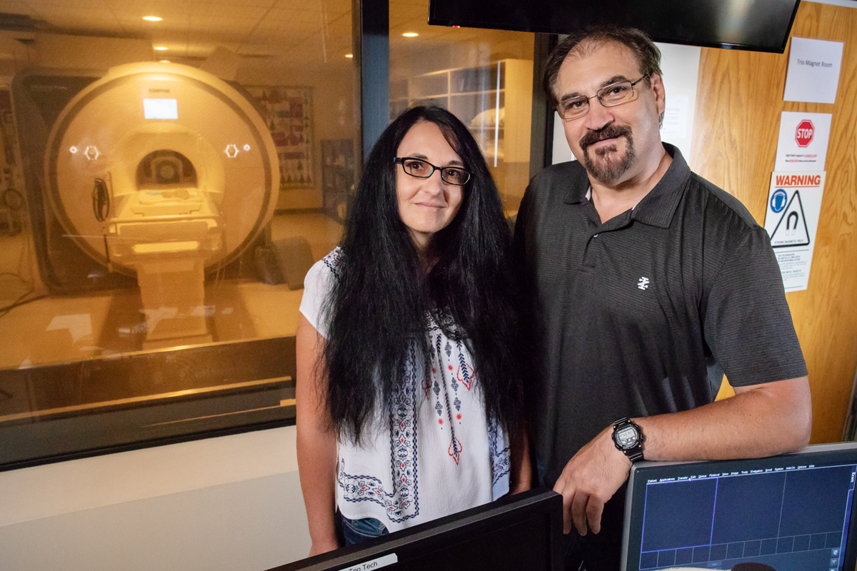 University of Illinois psychology professors Sanda Dolcos, left, and Florin Dolcos found that focusing on the contextual details of a triggered negative memory could help redirect focus to the task at hand.