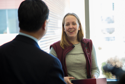 King Li, dean of the Carle Illinois College of Medicine, surprised Elizabeth Woodburn, then a bioengineering student at Illlinois, with her acceptance package.