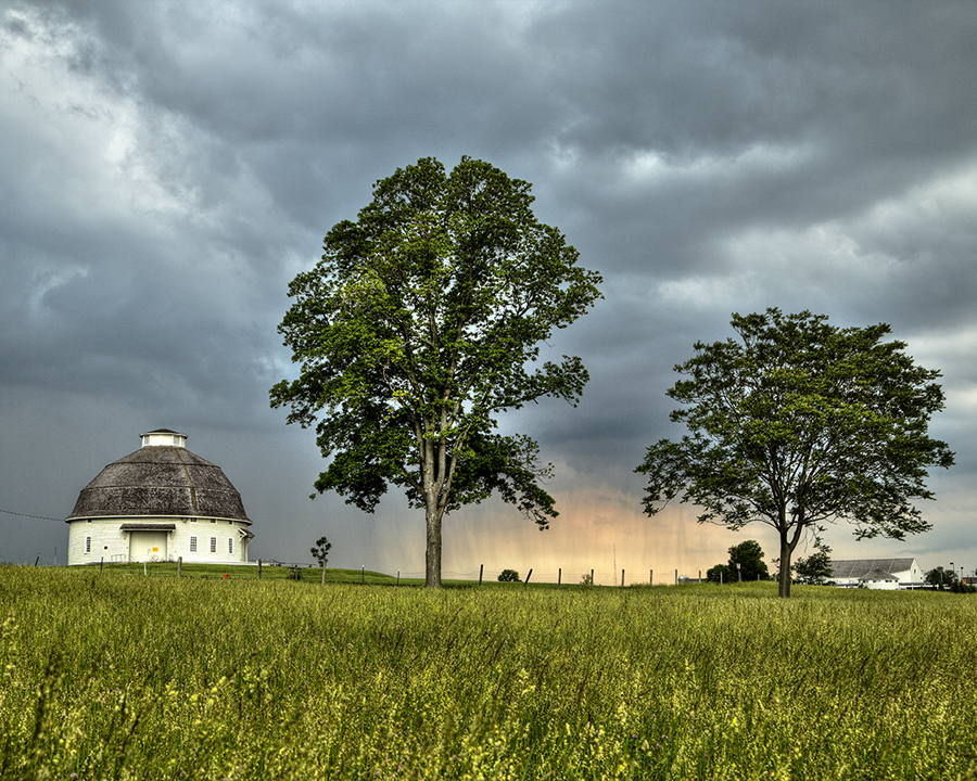 Summer storm clouds near a Round Barn and South Farms.