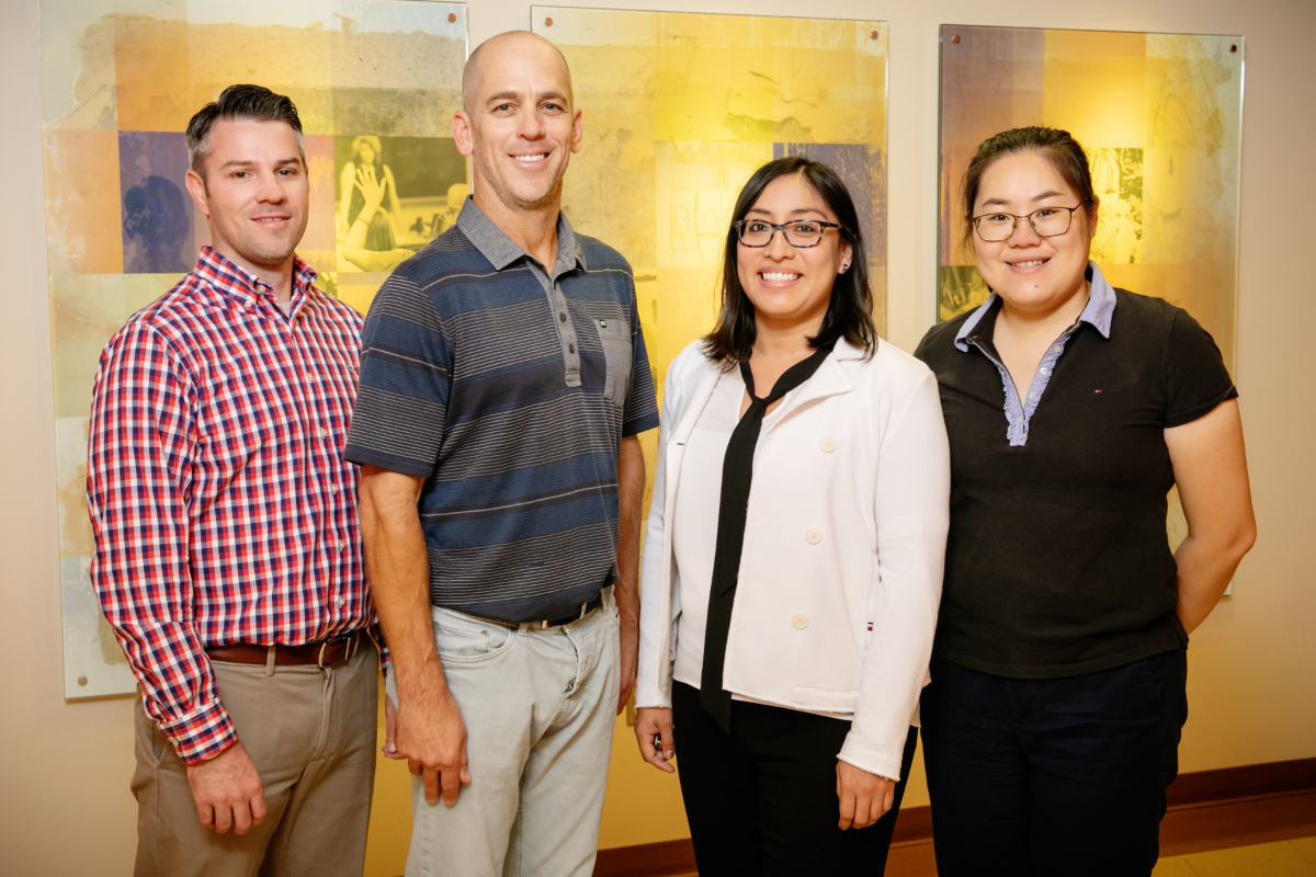 Hemodialysis patients who participated in an internet-based positive psychology program for five weeks significantly improved their depressive symptoms and ability to cope with their disease, according to a study led by University of Illinois researchers. The team included, from left:  graduate student Brett Burrows, kinesiology and community health professor Kenneth Wilund, social work professor Rosalba Hernandez and graduate student Shuo Xu.