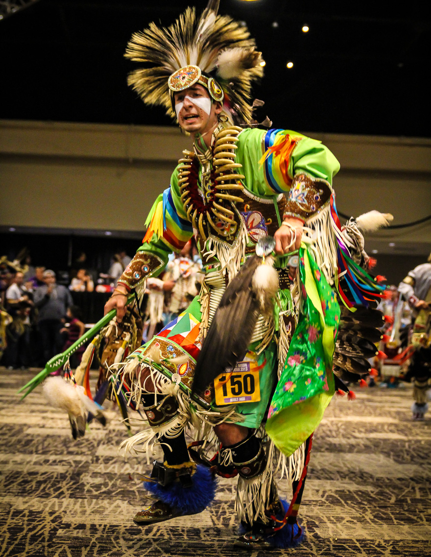 A Native American dancing in full regalia