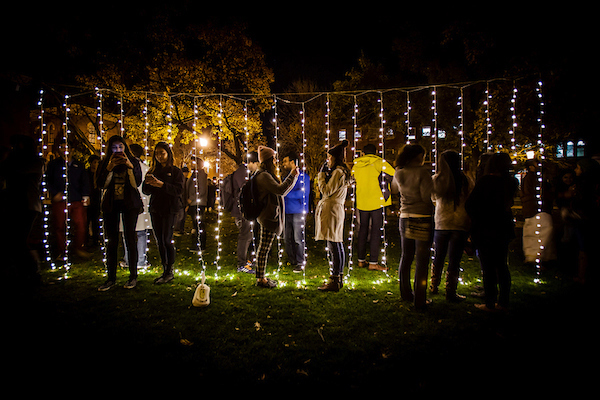 Students illuminated by lights