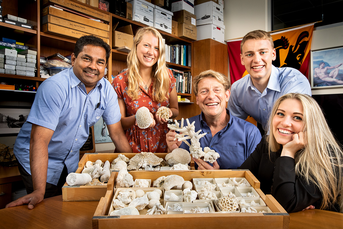 Using newly developed geological techniques, researchers, from left, microscopy expert Mayandi Sivaguru, Kaitlin Fouke, geologist and microbiologist Bruce Fouke, Kyle Fouke, Lauren Todorov and their colleagues made discoveries about the formational history of Porites coral skeletons to fine-tune the records used to make global climate predictions.