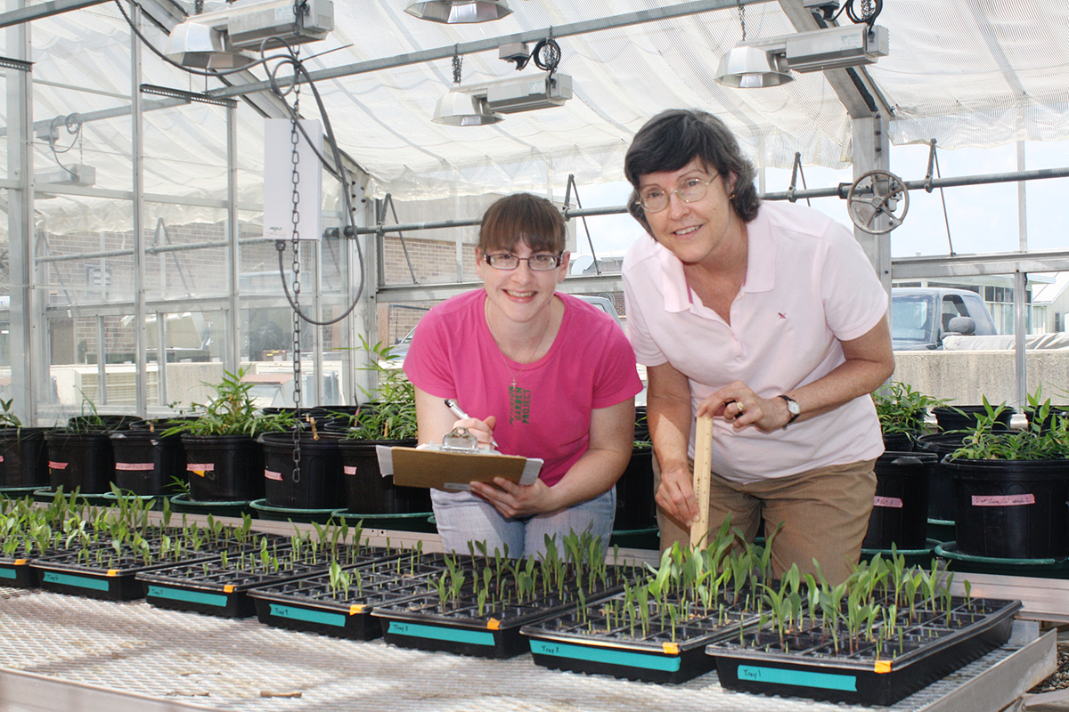 Illinois Sustainable Technology Center researchers Elizabeth Meschewski, left, and Nancy Holm and collaborators developed a systematic study to test the effectiveness of the soil additive biochar and found that it may not be as effective as previously thought.