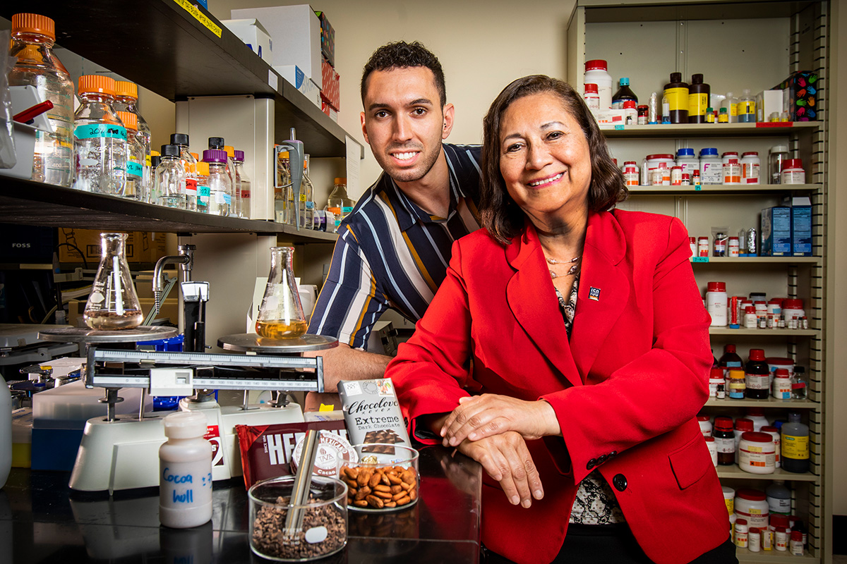Photo of food science professor Elvira Gonzalez de Mejia and graduate student Miguel Rebello-Hernanz