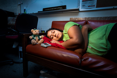 Sleep-deprived for science: Graduate student Ananya Sen rests briefly on the office couch.