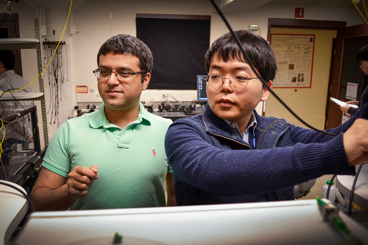 Mechanical sciences engineering professor Gaurav Bahl, left, and graduate student Seunghwi Kim confirmed that backscattered light waves can be suppressed to reduce data loss in optical communications systems.