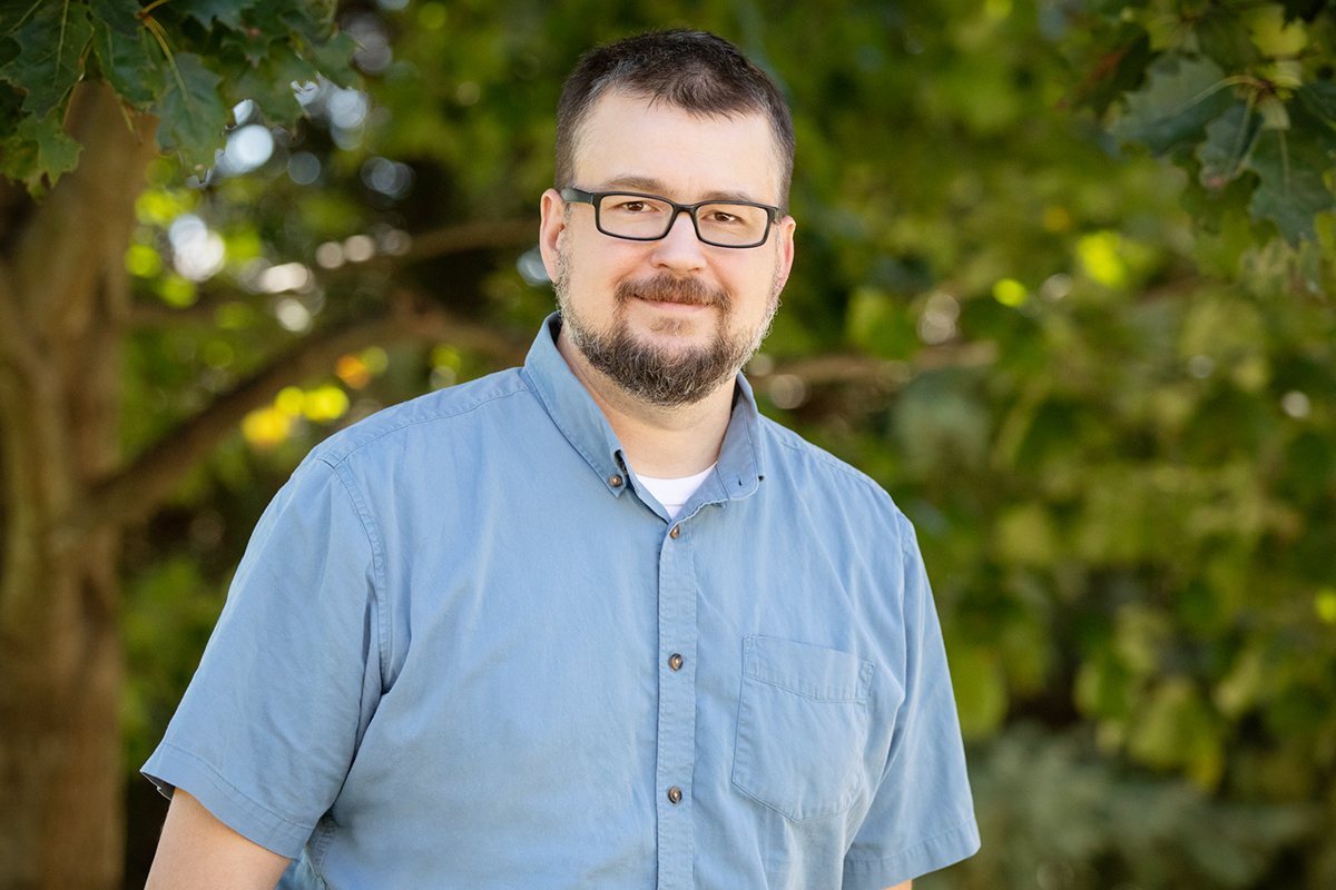 Thomas J. Benson leads the Critical Trends Assessment Program, which monitors the biological condition of Illinois' forests, wetlands and grasslands, and collects data on plants, birds and arthropods.