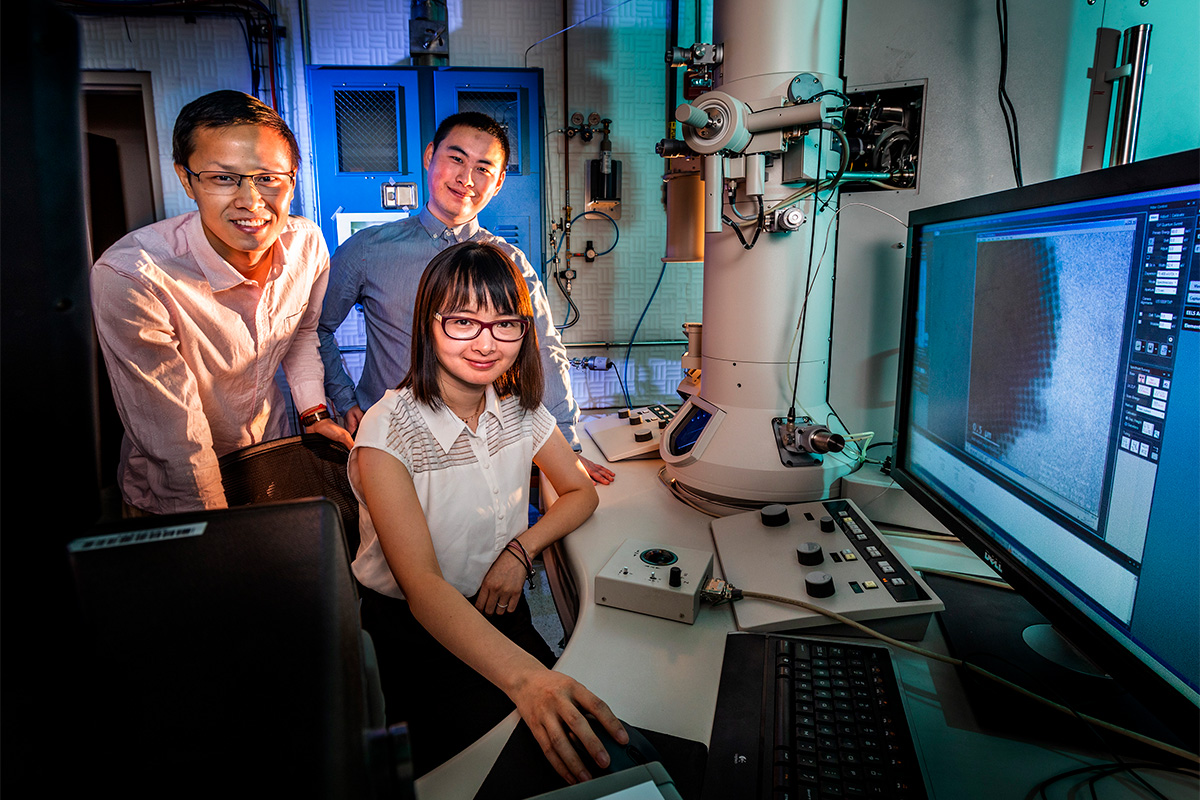 Professor Qian Chen, seated, and graduate students Binbin Luo, left, and Zihao Ou collaborated with researchers at Northwestern University to observe and simulate the formation of crystalline materials at a much higher resolution than before.