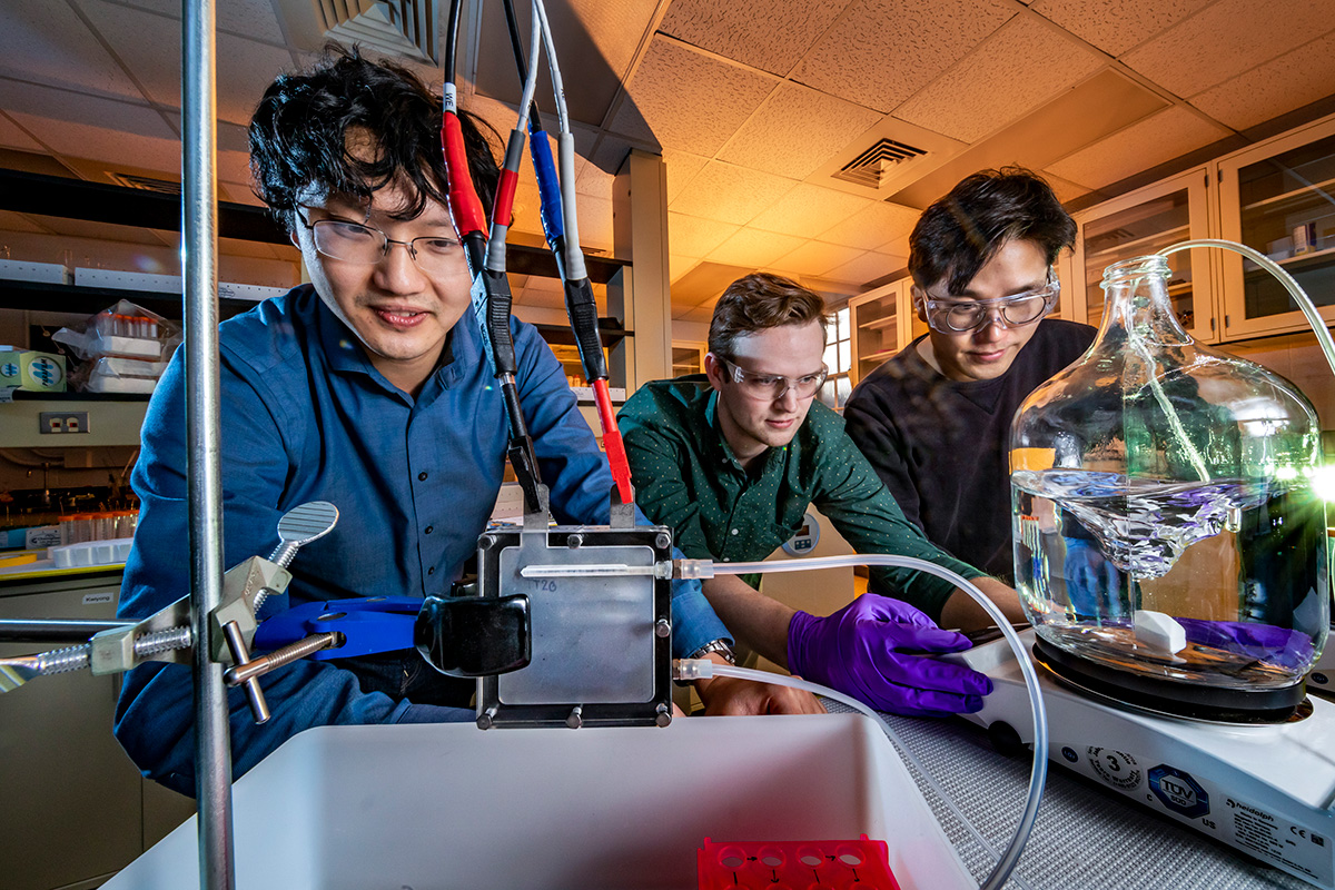 Professor Xiao Su, left, graduate student Stephen Cotty, center, and postdoctoral researcher Kwiyong Kim have developed an energy-efficient device that selectively absorbs a highly toxic form of arsenic in water and converts it into a far less toxic form.
