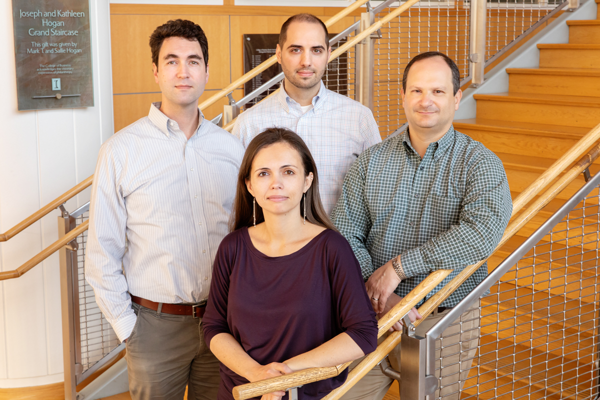 Photo of Gies College of Business finance professors Julian Reif, Tatyana Deryugina, David Molitor and Nolan Miller.