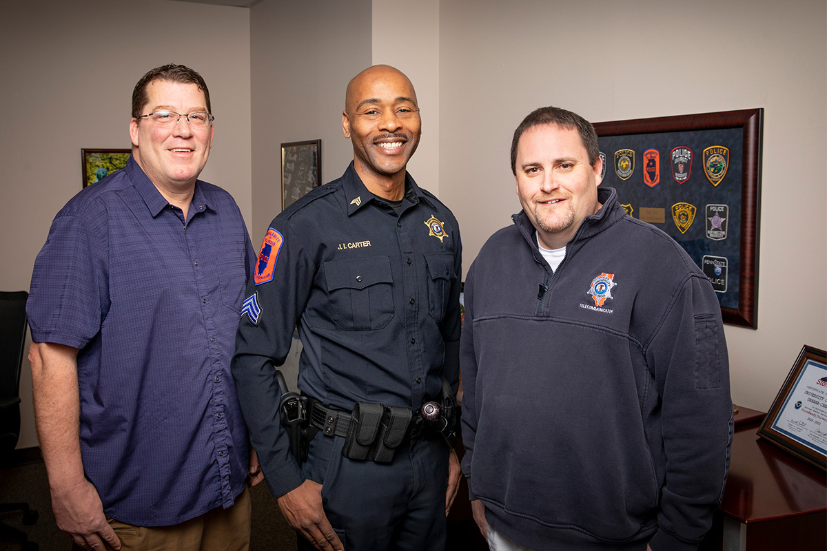 Chancellor's Medallion recipients, from left, Det. Eric Stiverson, Sgt. James Carter and telecommunicator Kenny Costa