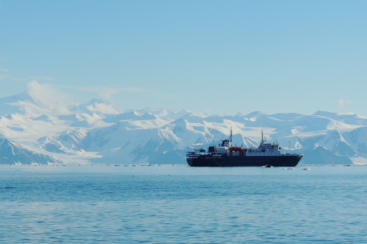 Image of the Admiralty Mountains at Cape Adare, Antarctica, and the ship Ortelius.