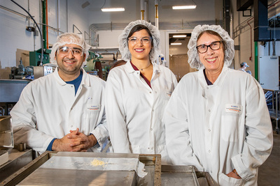 The team: Doctoral students Amir Malvandi and Nahla Kreidly, and food science professor Graciela Padua standing in their lab at the Agricultural Engineering Sciences Building.