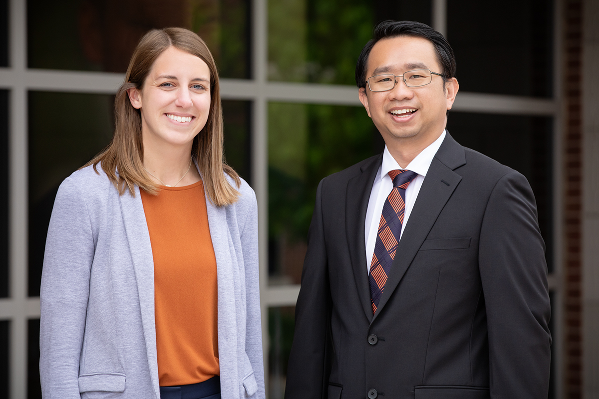 Social work professor Kevin Tan and alumna Jenna White standing outdoors
