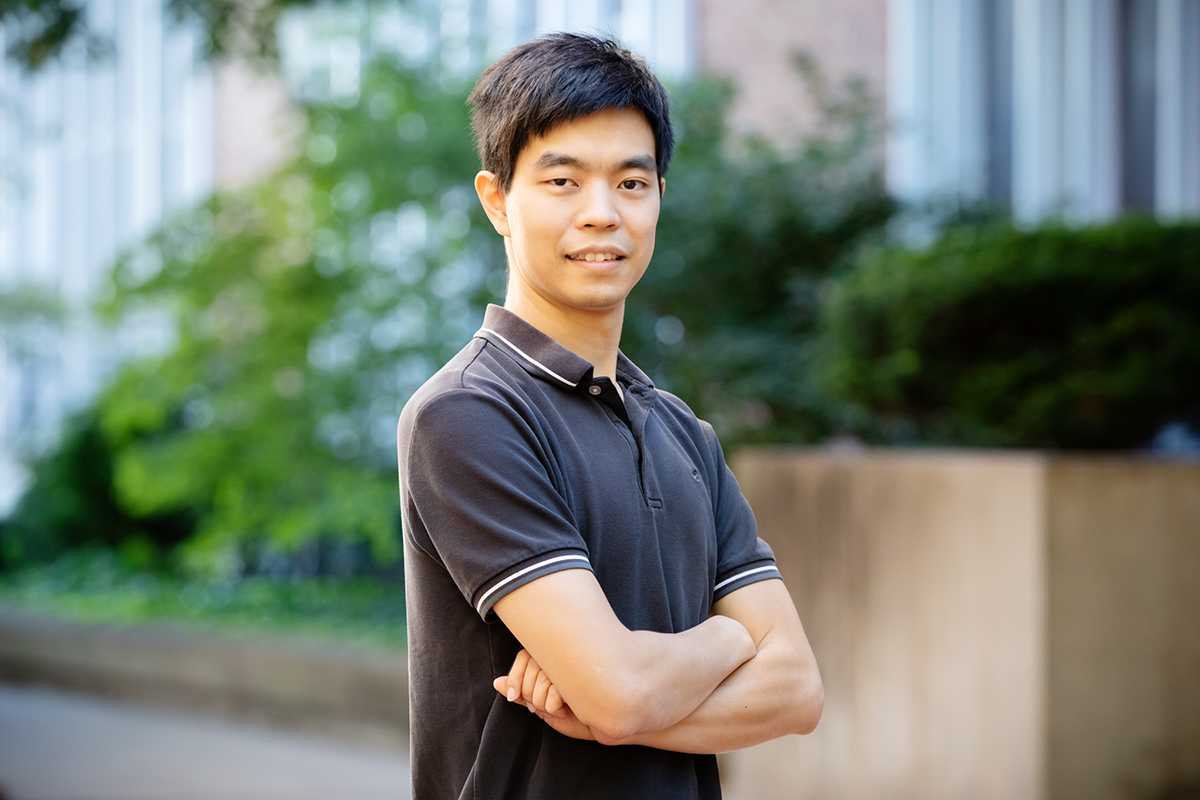 Nicholas Wu stands with arms crossed.